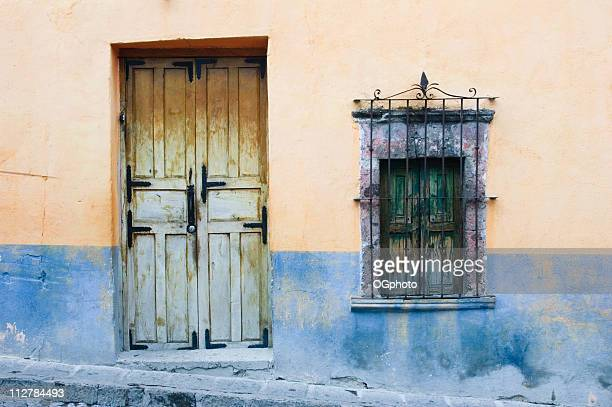 wooden against a colorful wall - ogphoto stock pictures, royalty-free photos & images