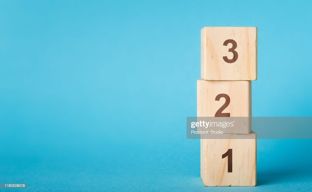 Wooden alphabet number blocks 123 on blue background : Stock Photo