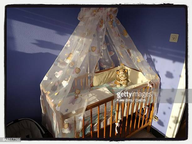 Wooden Baby Crib In Room