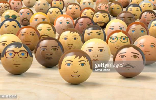Wooden balls with multi-ethnic faces on them. (low angle view)