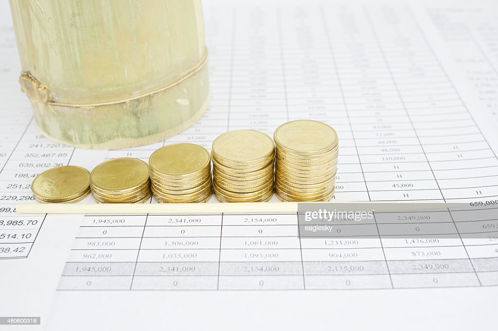 Wooden bamboo skewer and step pile of gold coins : Stock Photo