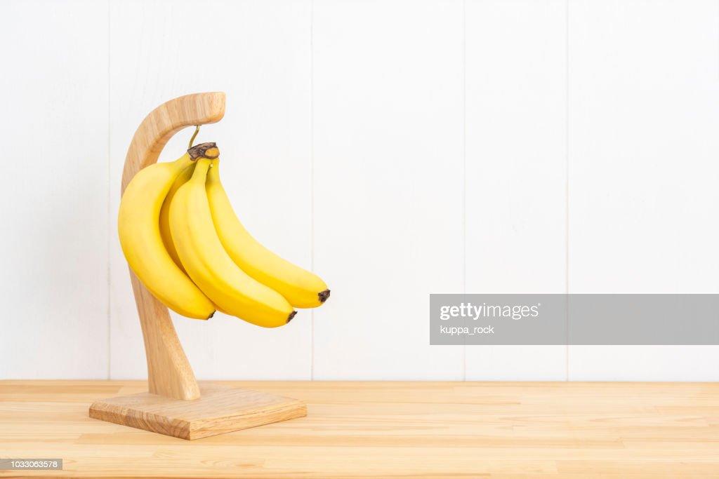 Wooden banana hanger : Stock Photo