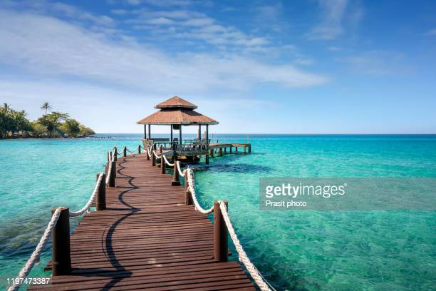 wooden bar in sea and hut with nice blue sky in koh kood at trat, thailand. asia summer, travel, vacation and holiday concept. - píer - fotografias e filmes do acervo