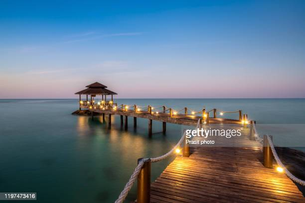 wooden bar in sea and hut with night sky in koh kood at trat, thailand. asia summer, travel, vacation and holiday concept. - thailand stock pictures, royalty-free photos & images