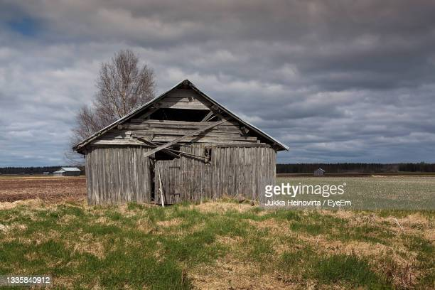 wooden barn houses stand on the early summer fields of the rural finland. - heinovirta stock pictures, royalty-free photos & images