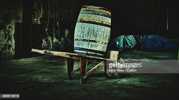 wooden barrels at winery - dolly reed stock photos and pictures