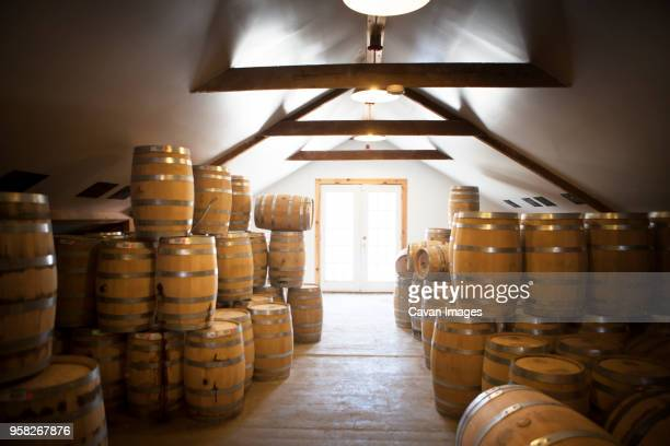 wooden barrels in whiskey factory - distillery stock pictures, royalty-free photos & images