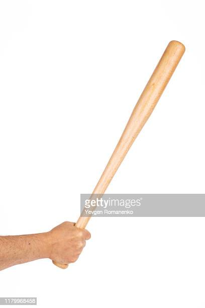 wooden baseball bat in hand isolated on white background - baseball bat stock pictures, royalty-free photos & images