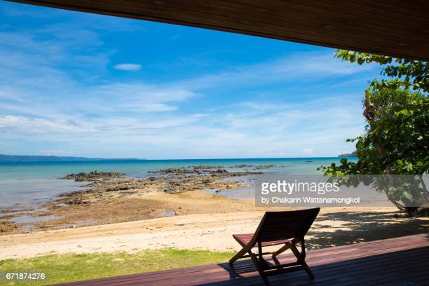 Wooden Beach Chair on the Terrace with Sea View and Blue Sky.