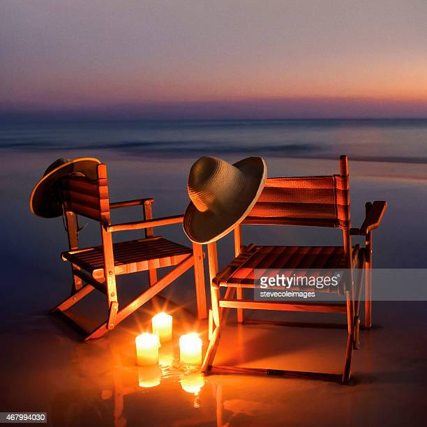 wooden beach chairs on beach at sunset or sunrise, - destin beach stock pictures, royalty-free photos & images