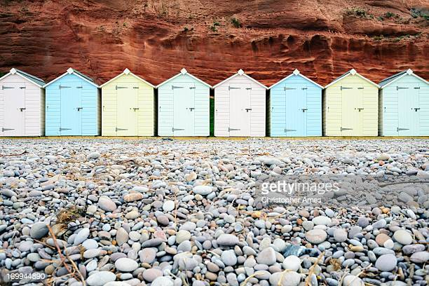 wooden beach huts - pebble stock photos and pictures