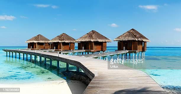 Wooden beach villas on tropical waters