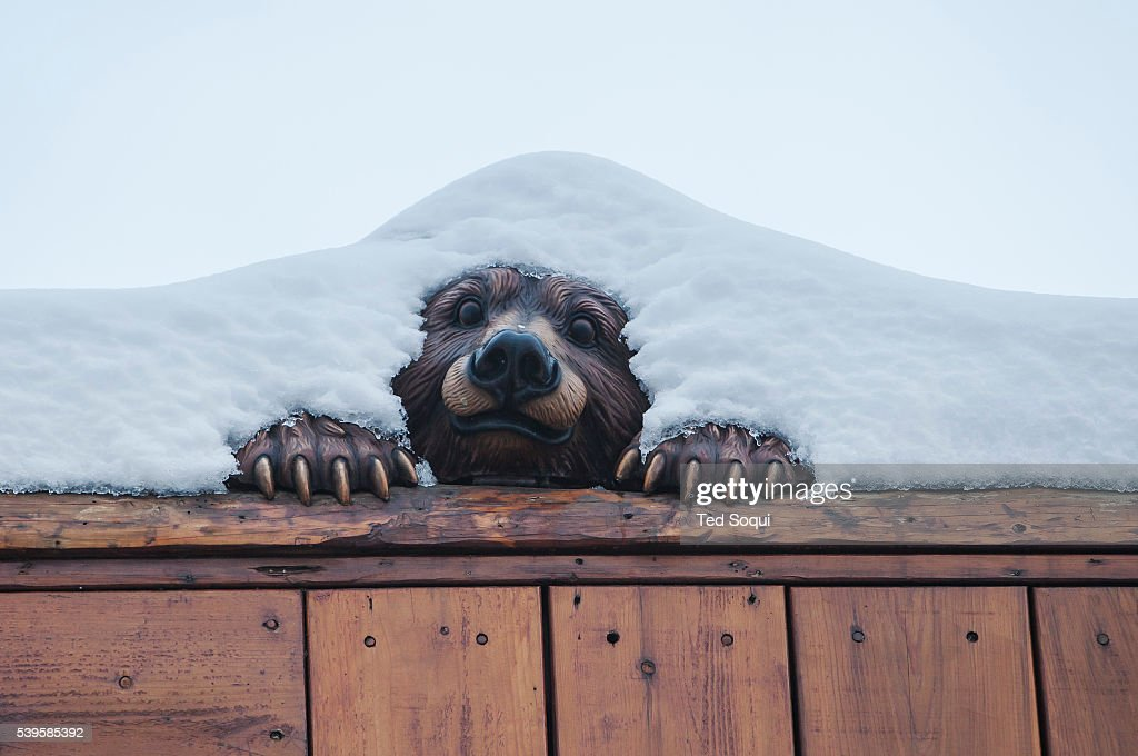 A Wooden Bear Carving Covered With Snow In Big Bear Ca El Niño