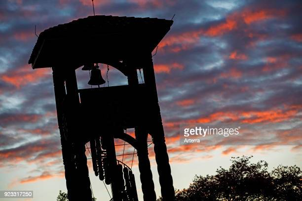 Wooden belltower of the Jesuit Church of the Missions silhouetted against sunset at Concepcion Nuflo de Chavez Santa Cruz Bolivia