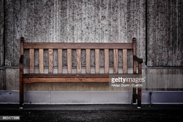 wooden bench against wall - niklas storm eyeem stock photos and pictures