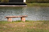 wooden bench sun lake shore this