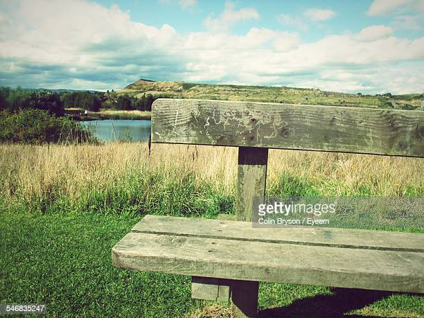 Wooden Bench On Lakeshore