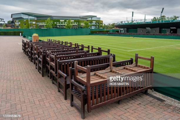 Wooden benches are stored by Court 12 at the All England Lawn Tennis Club in west London on June 27 2020 on what would have been the first day of the...