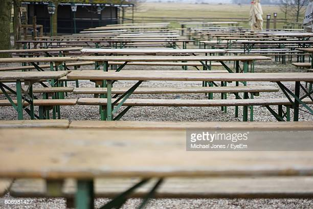 Wooden Benches Arranged At Park