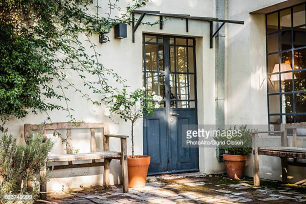 wooden benches in residential courtyard - courtyard stock photos and pictures