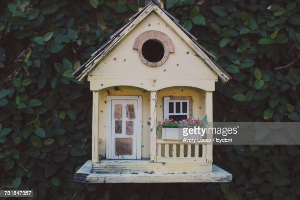 wooden birdhouse against leaves - birdhouse stock pictures, royalty-free photos & images