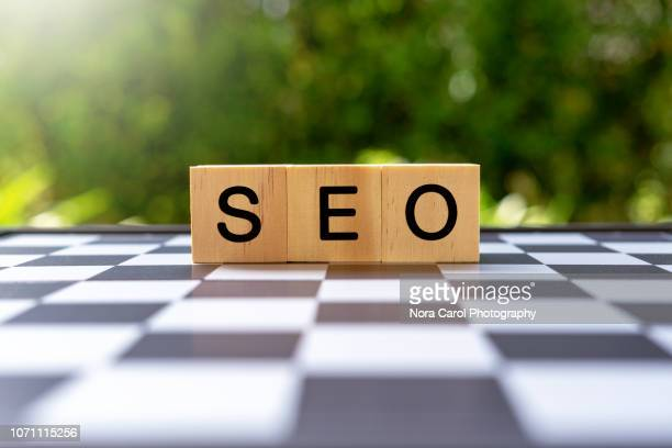 wooden block with text seo - search engine stock photos and pictures
