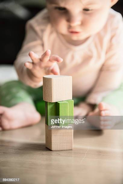 Wooden blocks, baby on background