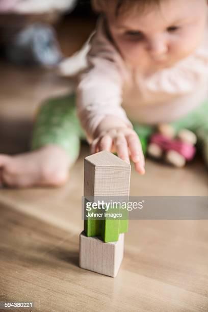 Wooden blocks, baby on background