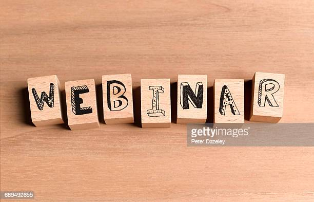 Wooden blocks spelling out the word webinar
