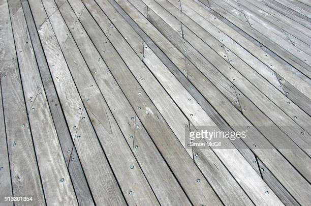 wooden boards of the wharf at commonwealth place, australian capital territory, australia - the slants stock pictures, royalty-free photos & images