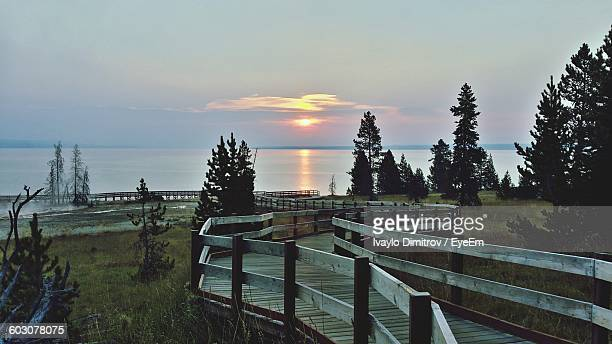 Wooden Boardwalk Against Sea During Sunset