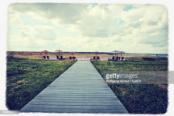 wooden boardwalk - massa stock pictures, royalty-free photos & images