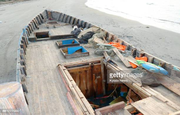 A wooden boat apparently from North Korea is found washed ashore with eight bodies on a beach in the city of Oga Akita Prefecture in northern Japan...