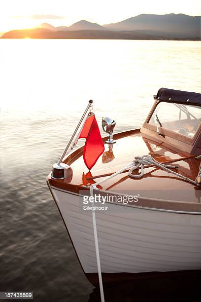 Wooden boat at anchor during sunset