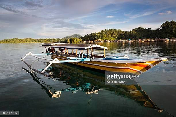 wooden boat in indonesia - didier marti stock photos and pictures