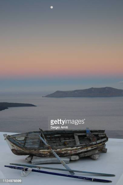 Wooden boat overlooking the Aegean sea