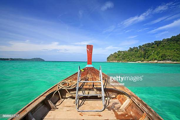 wooden boat sailing to snorkel spot near Koh Lipe