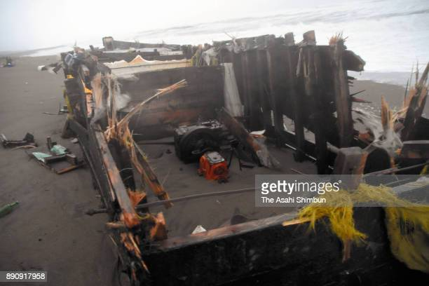 A wooden boat with Hangul character is washed ashore at a beach on December 12 2017 in Kashiwazaki Niigata Japan Two male bodies were found from the...