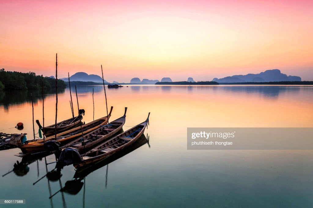 Wooden boats in the sea at sunset, Phuket,Thailand. : Stock Photo