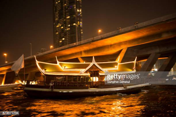 Wooden Boats with thai roof on Chao Praya river
