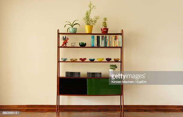 Wooden Bookshelf Against Wall At Home