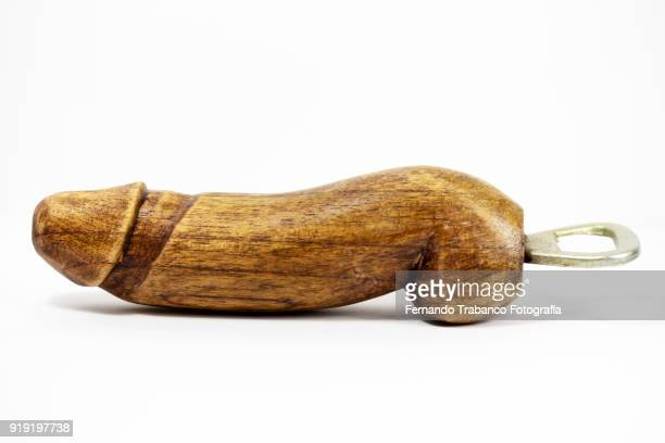 wooden bottle opener with penis shape - consolador fotografías e imágenes de stock