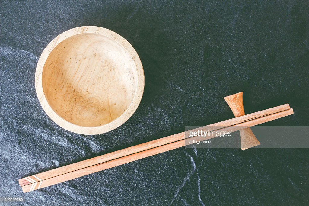 Wooden bowl and wooden chopsticks : Stock Photo