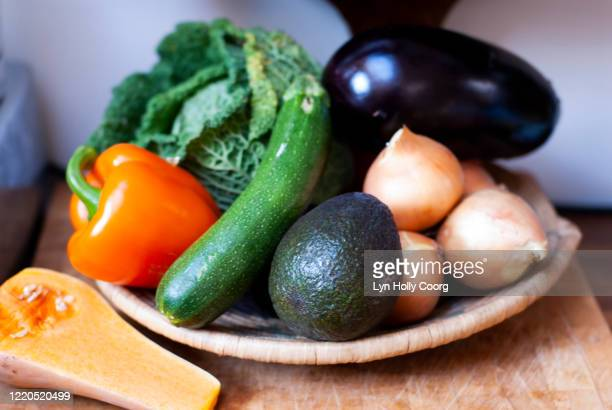 wooden bowl full of fresh vegetables - lyn holly coorg stock pictures, royalty-free photos & images