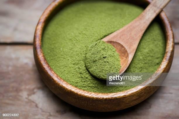 Wooden bowl of organic Moringa powder