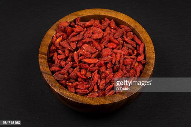 wooden bowl with goji berries