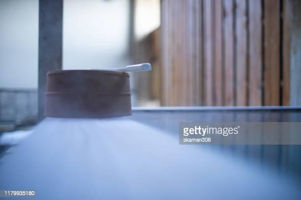 wooden bowl with hot onsen bath - 温泉 ストックフォトと画像