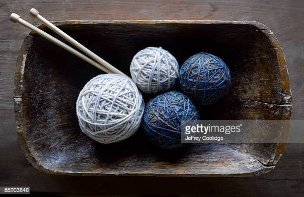 Wooden Bowl with Yarn and Knitting Needles