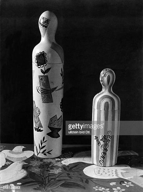 Wooden bowlingpin shaped containers for small bottles or embroidery needles 1943 Photographer Regine Relang Published by 'Berliner Illustrirte...