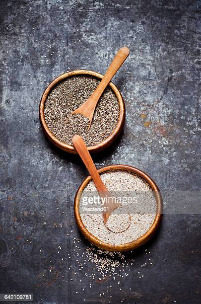 Wooden bowls of black and white chia seeds